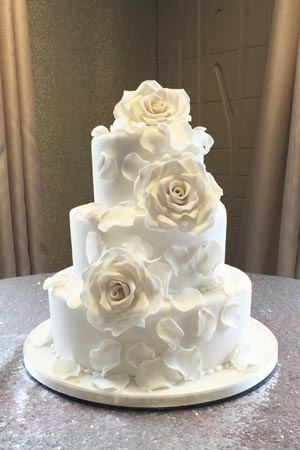 Wedding Cakes - Large White Flower Cascade Wedding Cake