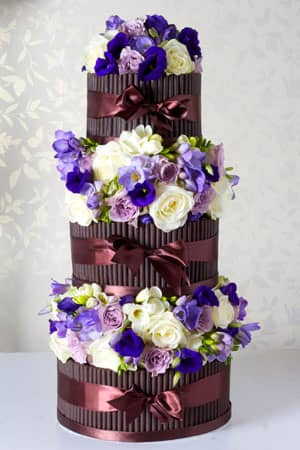 Wedding Cakes - Purple Flowers and Dark Chocolate Cigarello